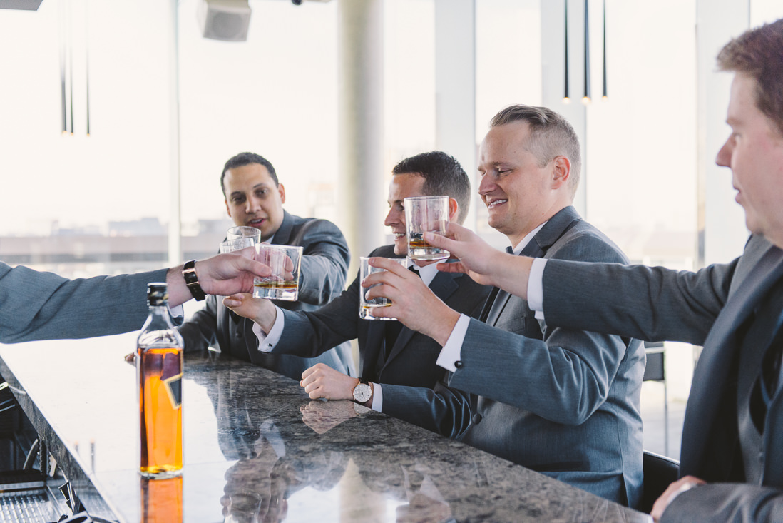 Groom having a drink with Groomsmen | Thompson Hotel Wedding, Toronto | EIGHTYFIFTH STREET PHOTOGRAPHY