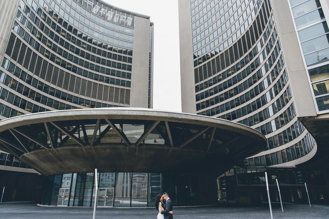 Bride & Groom in front of Toronto City Hall Building   Toronto City Hall Wedding   EIGHTYFIFTH STREET PHOTOGRAPHY