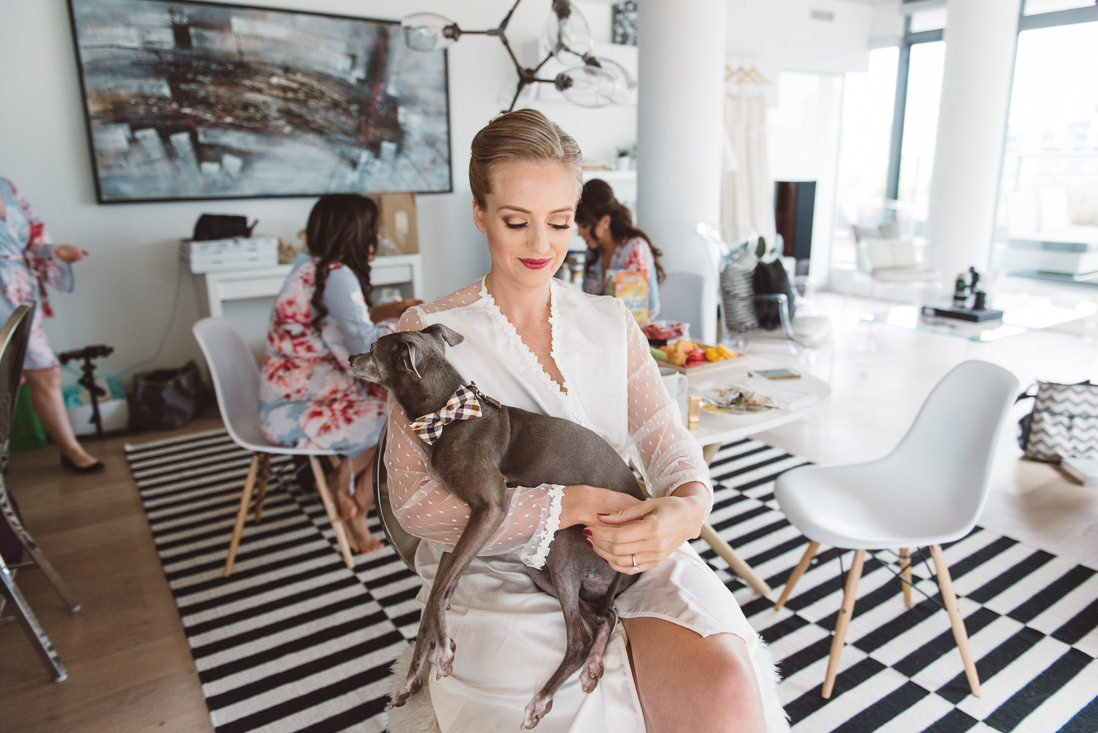 Bride getting ready at Six50 King Street AirBNB Toronto with her pet greyhound | EIGHTYFIFTH STREET PHOTOGRAPHY