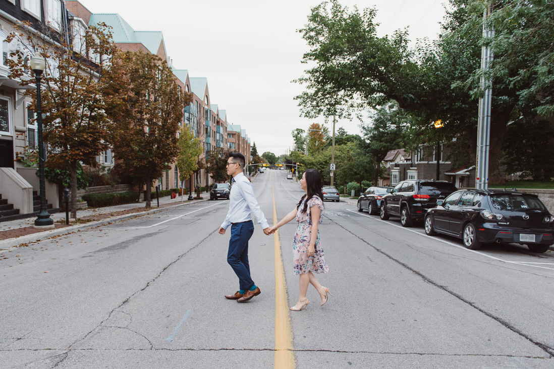 Couple crossing street | Downtown Oakville Engagement | EightyFifth Street Photography