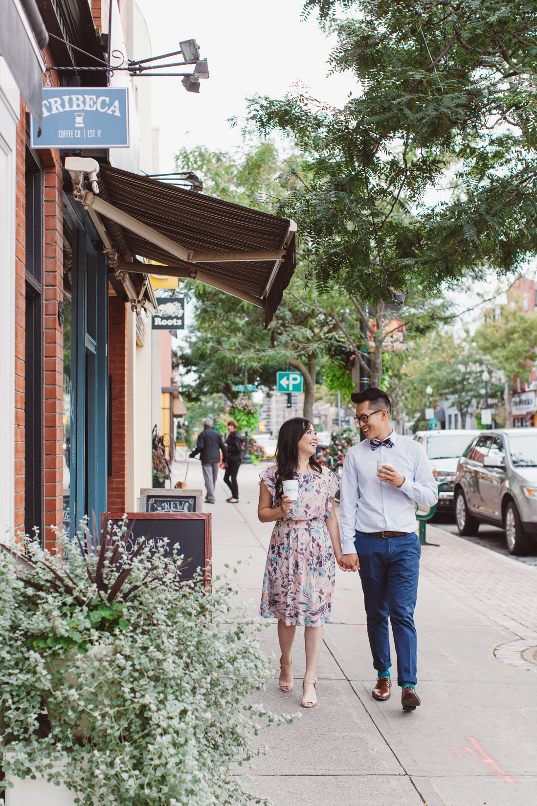 Couple walking on street | Downtown Oakville Engagement | EightyFifth Street Photography