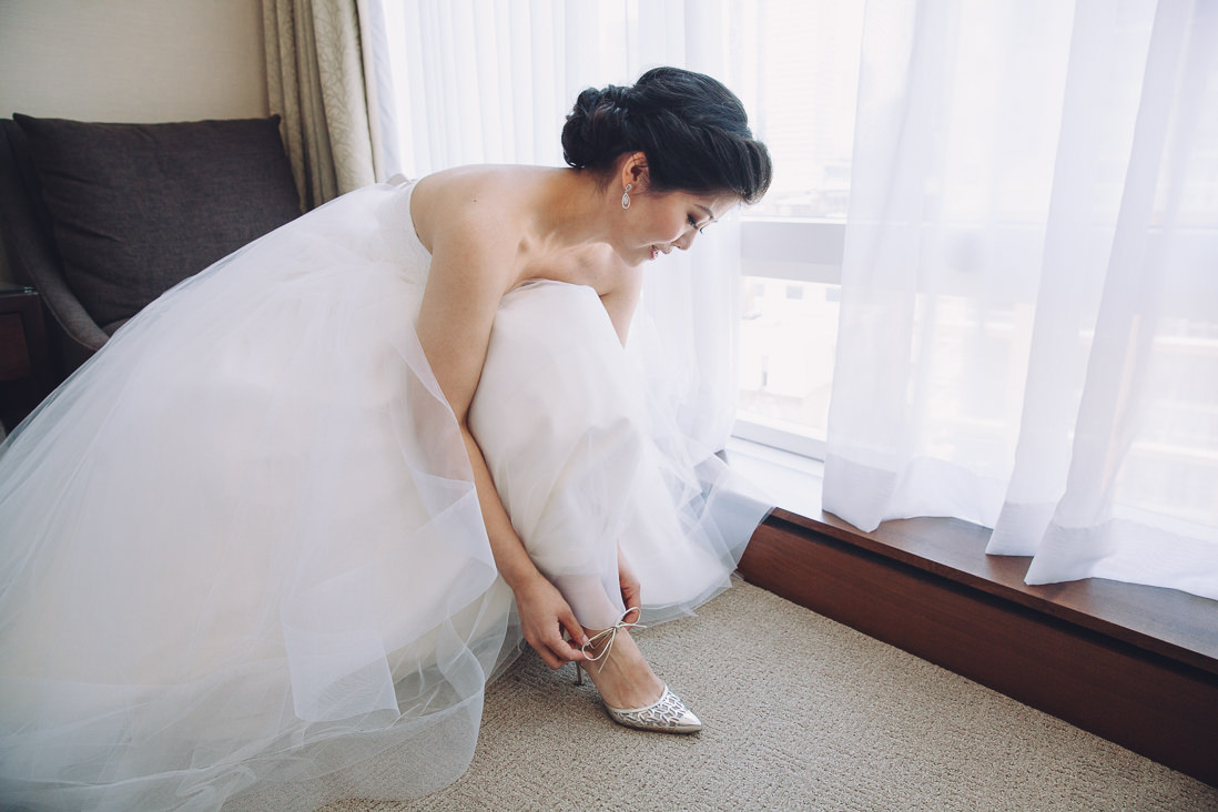 Bride putting on wedding shoes | Arcadian Loft Wedding, Toronto | EIGHTYFIFTH STREET PHOTOGRAPHY