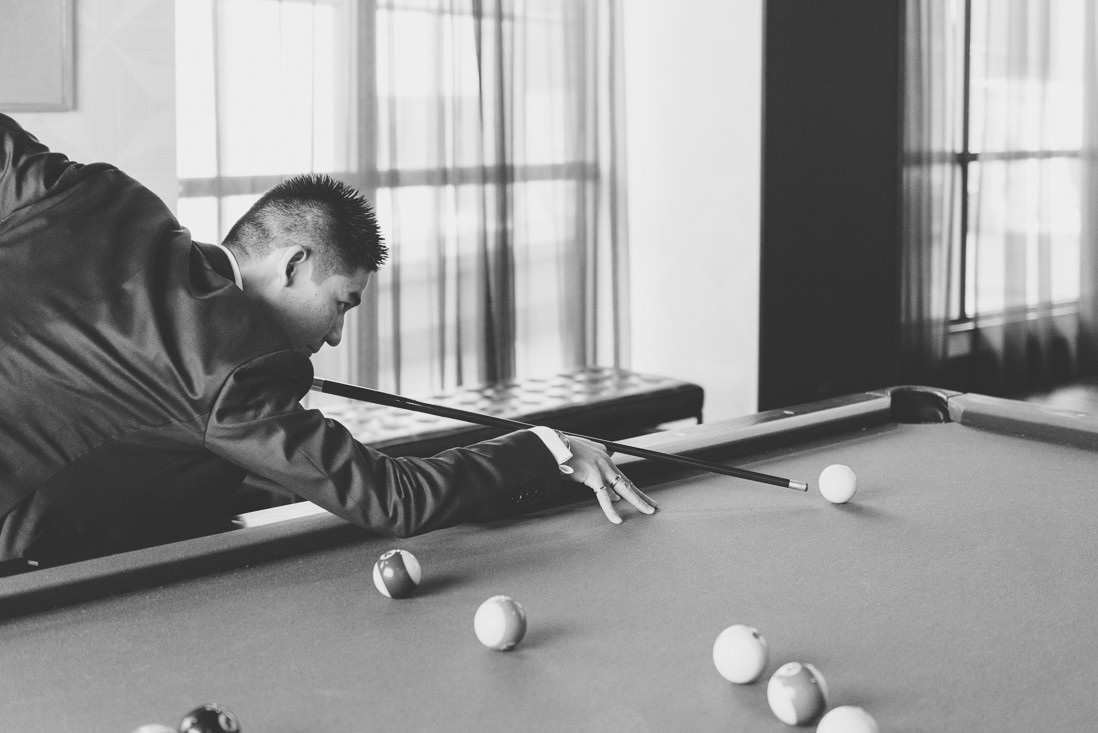 Groom playing pool | Arcadian Loft Wedding, Toronto | EIGHTYFIFTH STREET PHOTOGRAPHY