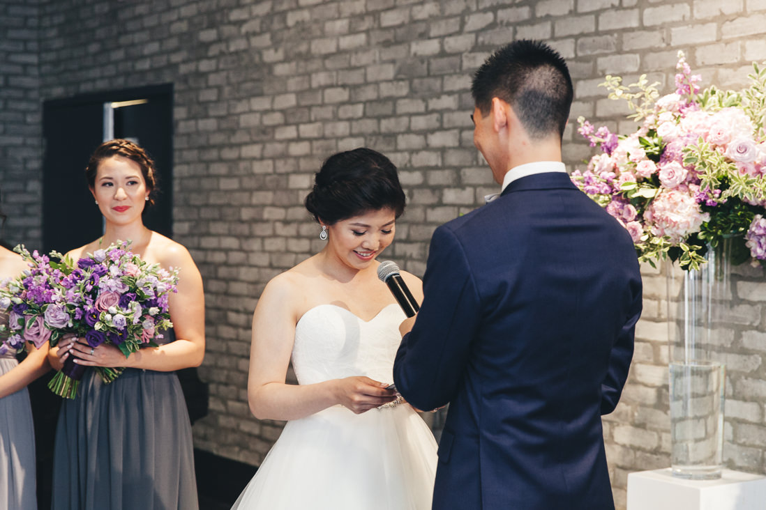 Reading vows during wedding ceremony | Arcadian Loft Wedding, Toronto | EIGHTYFIFTH STREET PHOTOGRAPHY