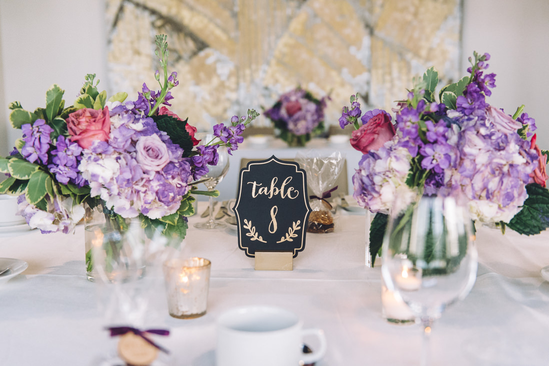 Black & Gold table numbers with purple centrepieces | Arcadian Loft Wedding, Toronto | EIGHTYFIFTH STREET PHOTOGRAPHY