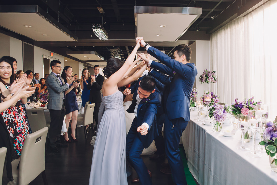 Human tunnel entry at wedding reception | Arcadian Loft Wedding, Toronto | EIGHTYFIFTH STREET PHOTOGRAPHY