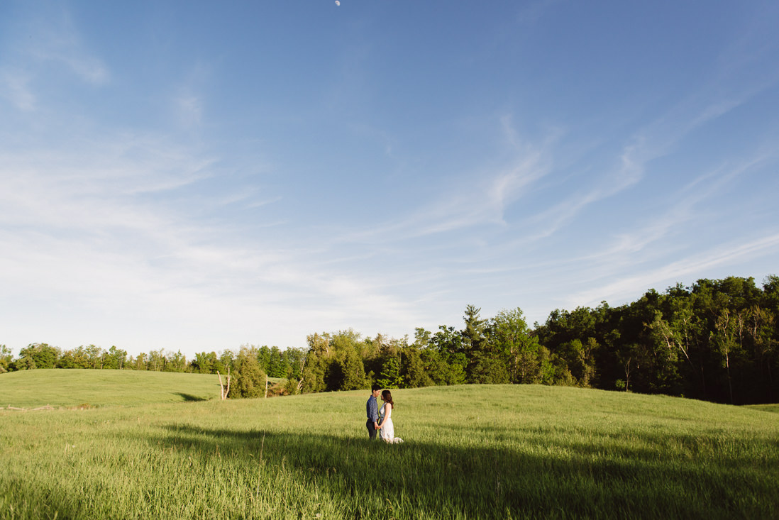Wide shot of couple in field of tall grass | Scotsdale Farm Engagement, Georgetown | Toronto Wedding Photographer | EightyFifth Street Photography