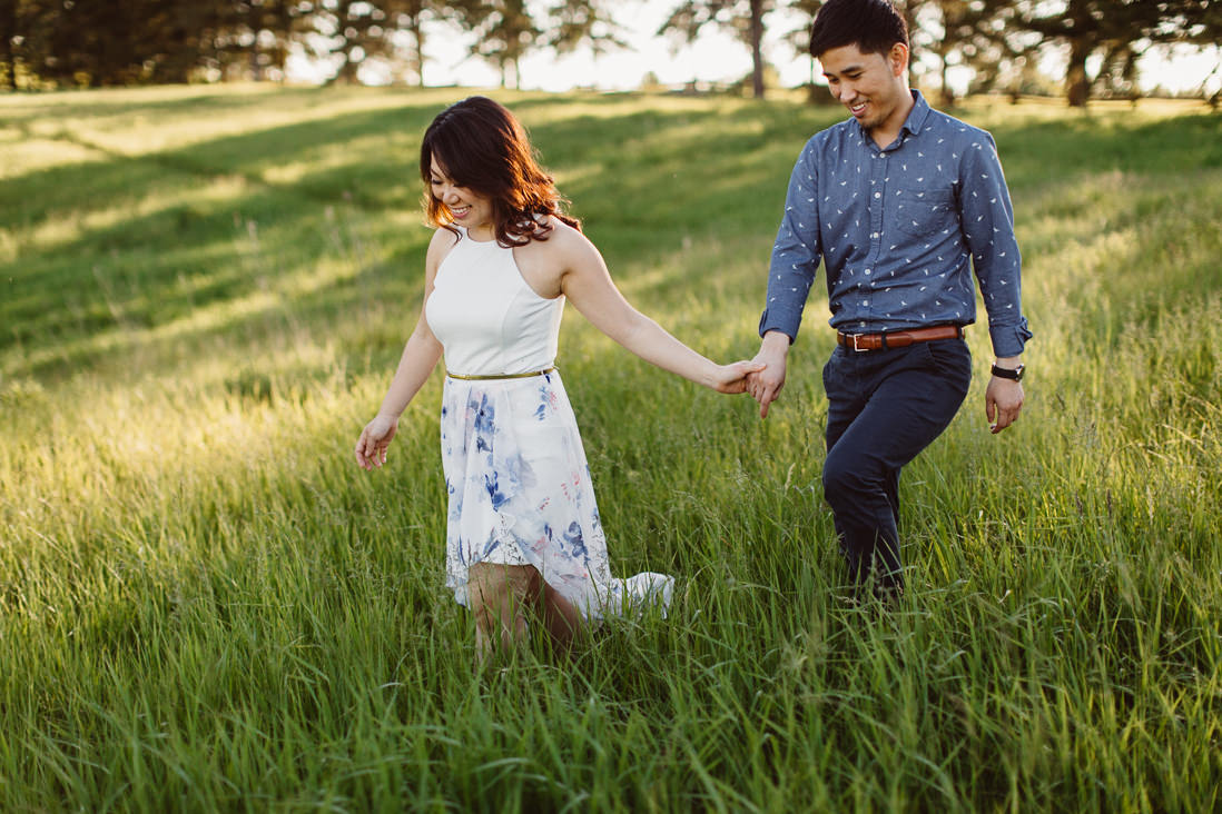 Couple walking in field of tall grass | Scotsdale Farm Engagement, Georgetown | Toronto Wedding Photographer | EightyFifth Street Photography