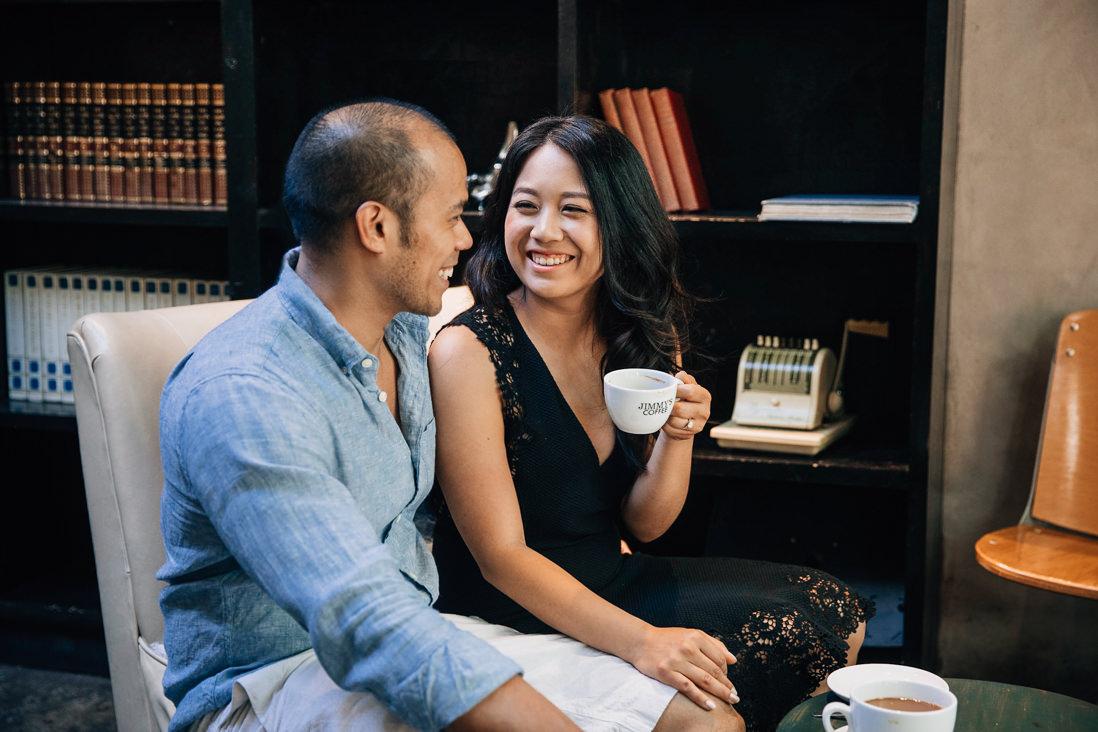 Couple having coffee at Jimmy's Coffee   Kensington Market Engagement   Toronto Wedding Photographer   EightyFifth Street Photography