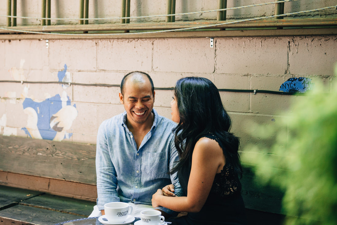 Couple having coffee at Jimmy's Coffee back patio   Kensington Market Engagement, Toronto   EightyFifth Street Photography