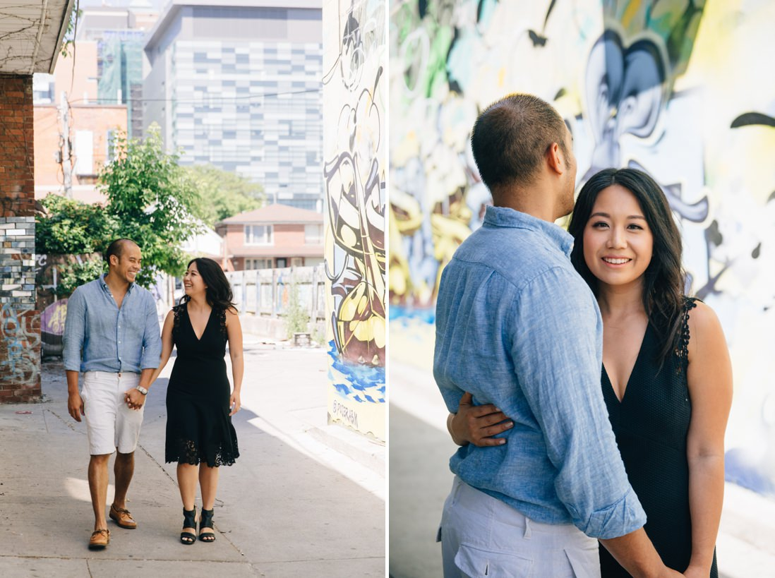 Couple walking in graffiti alleyway | Kensington Market Engagement, Toronto | EightyFifth Street Photography