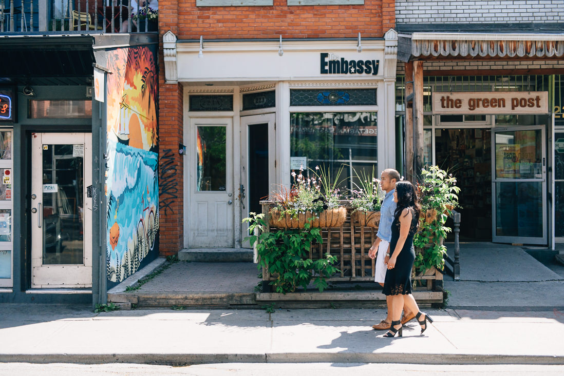 Couple walking on the sidewalk | Kensington Market Engagement, Toronto | EightyFifth Street Photography