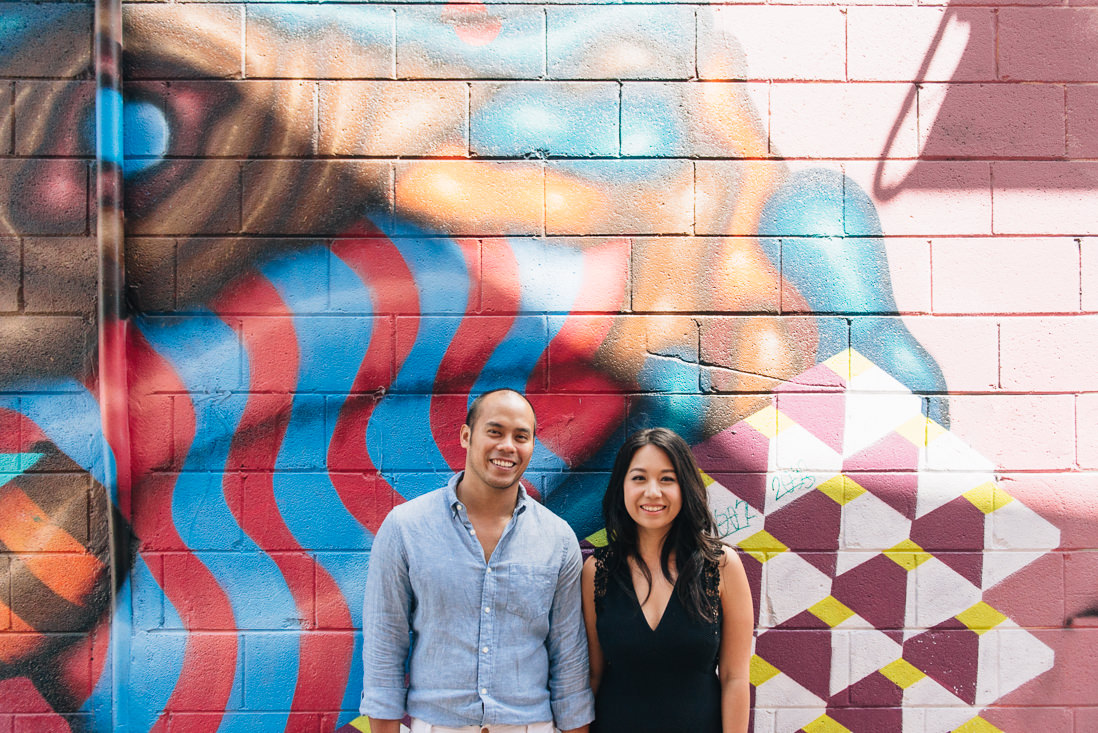 Couple laughing in graffiti alleyway | Kensington Market Engagement, Toronto | EightyFifth Street Photography