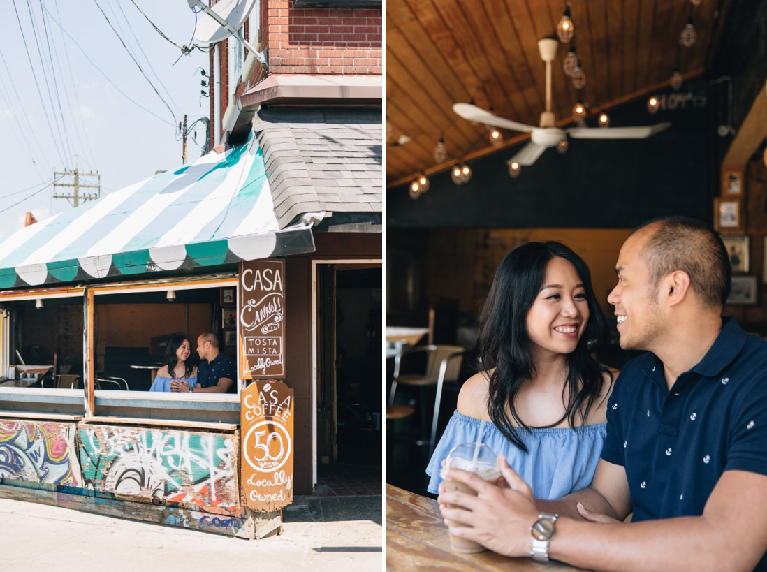 Couple overlooking street inside rustic coffee shop | Kensington Market Engagement, Toronto | EightyFifth Street Photography