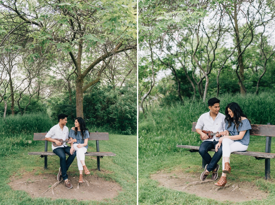 Man playing ukulele on a bench with fiancee | Humber Bay Park Engagement Etobicoke | EightyFifth Street Photography