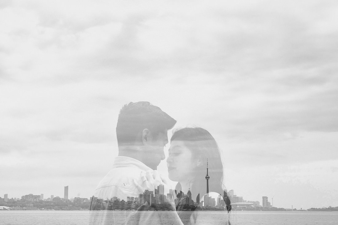 Black & White double exposure of couple over Toronto skyline | Humber Bay Park Engagement | EightyFifth Street Photography