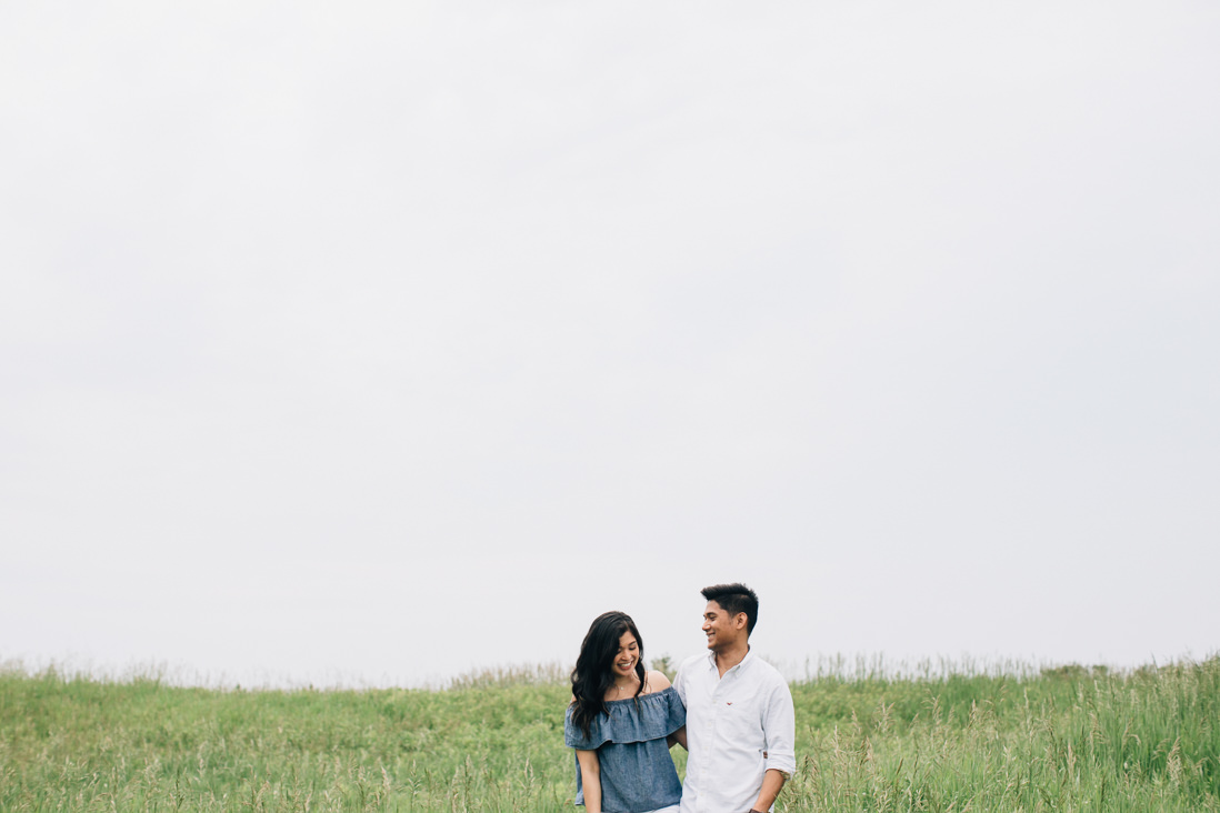 Couple laughing in open field | Humber Bay Park Engagement | EightyFifth Street Photography