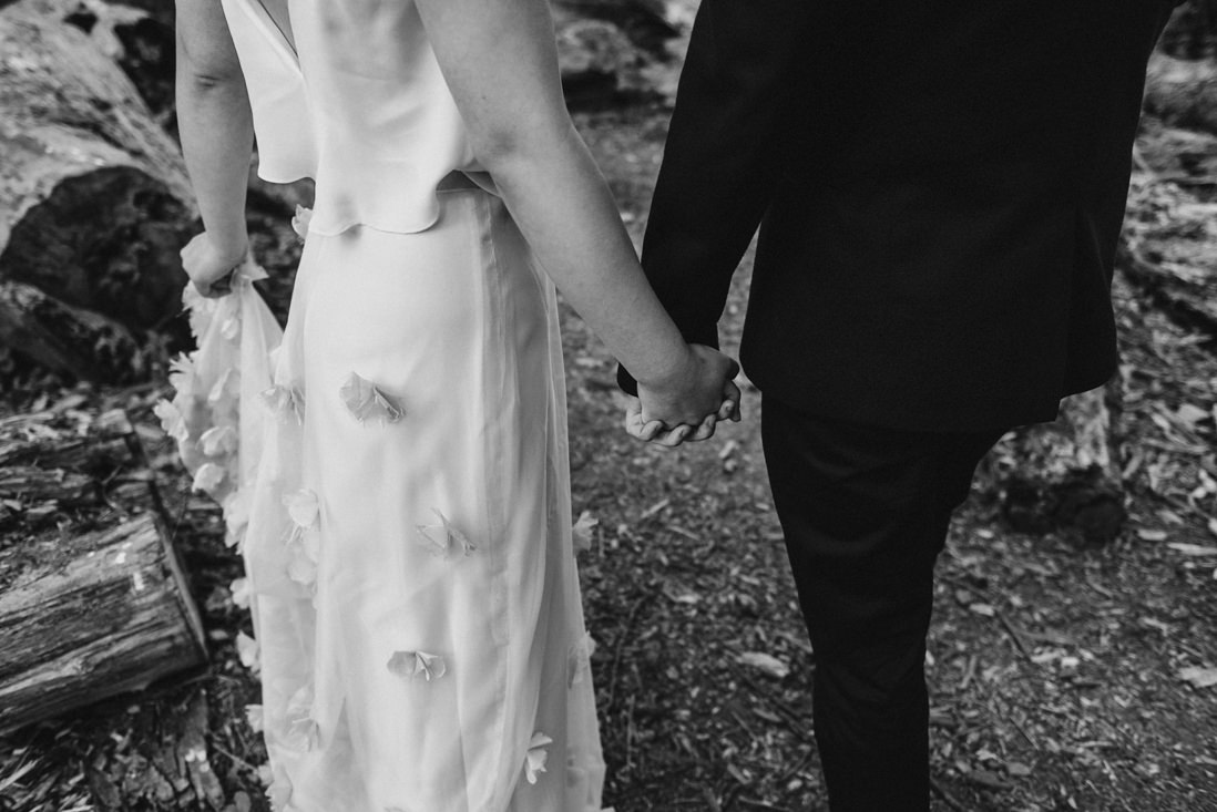 black & white photo of bride & groom holding hands | eightyfifth street photography