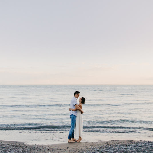 Couple hugging at the beach | Summer Scarborough Bluffs Engagement | EightyFifth Street Photography