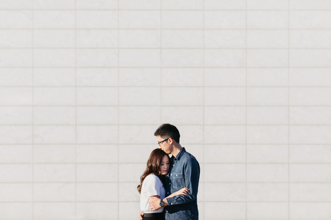 Couple hugging | Aga Khan Museum engagement | Minimalist portrait location | Toronto Wedding Photographer | EightyFifth Street Photography