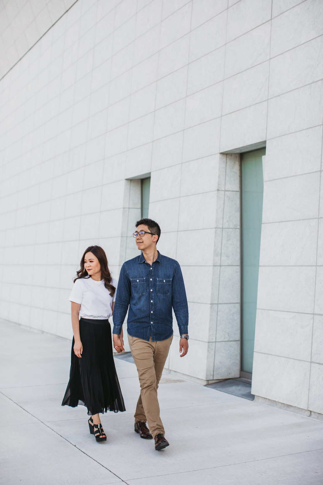 Couple Walking outside modern building | Aga Khan Museum engagement | Minimalist portrait location | Toronto Wedding Photographer | EightyFifth Street Photography