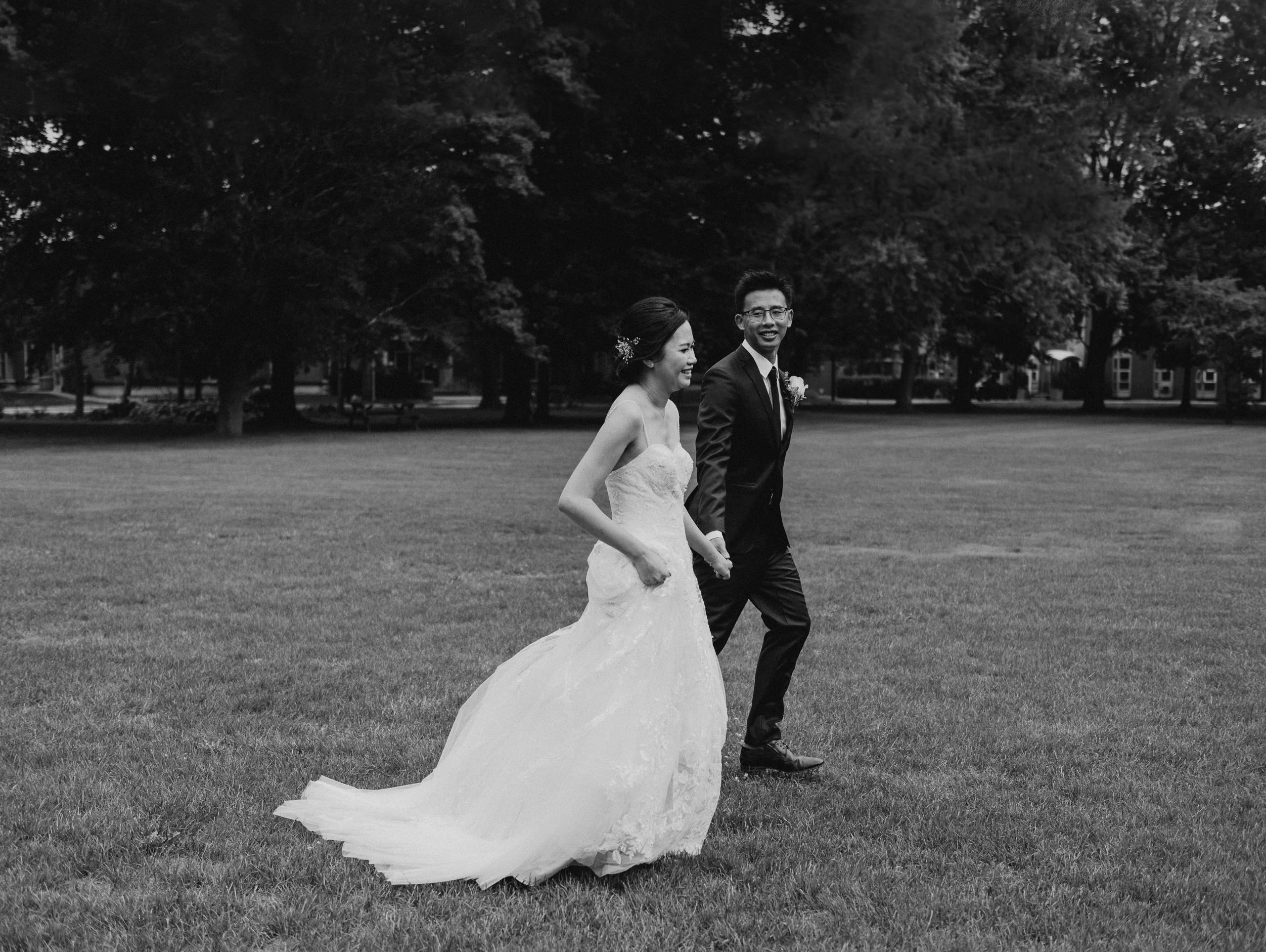 Black and White wedding photo of Bride and Groom at York University Glendon Campus, Documentary style Toronto Wedding Photographer