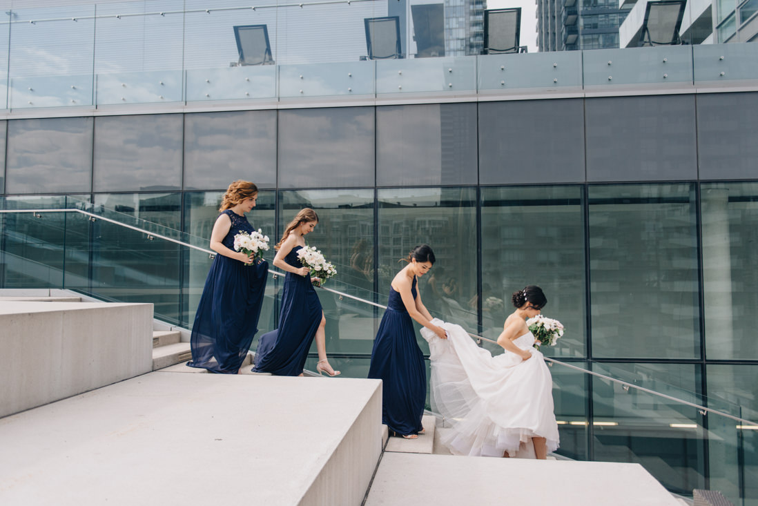 bridal party descending steps on terrace at malaparte wedding toronto