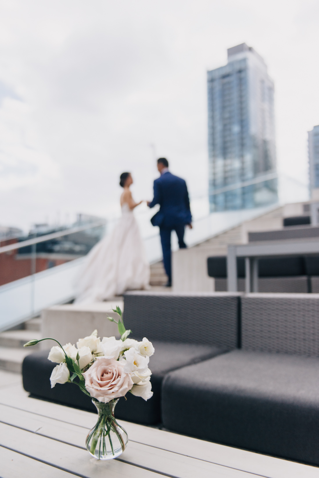 bride and groom walking up steps on malaparte terrace bell tiff lightbox toronto