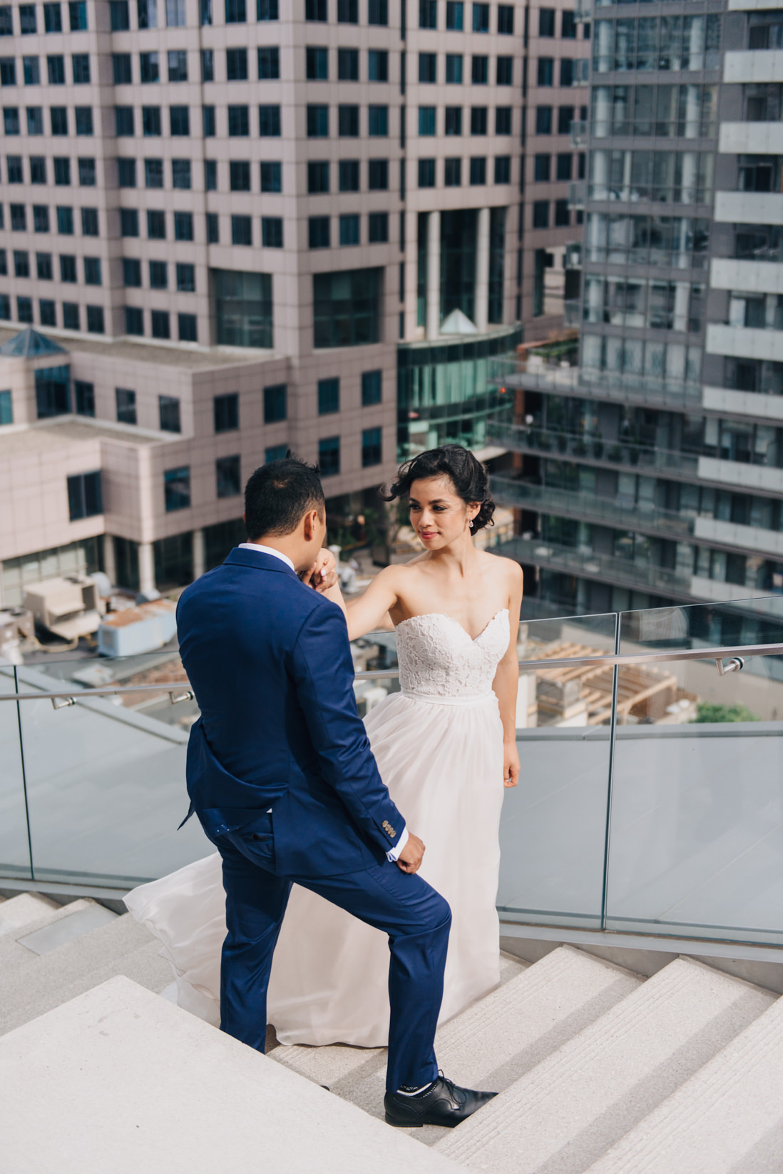 groom kissing brides hands on steps at malaparte wedding toronto wedding photographer