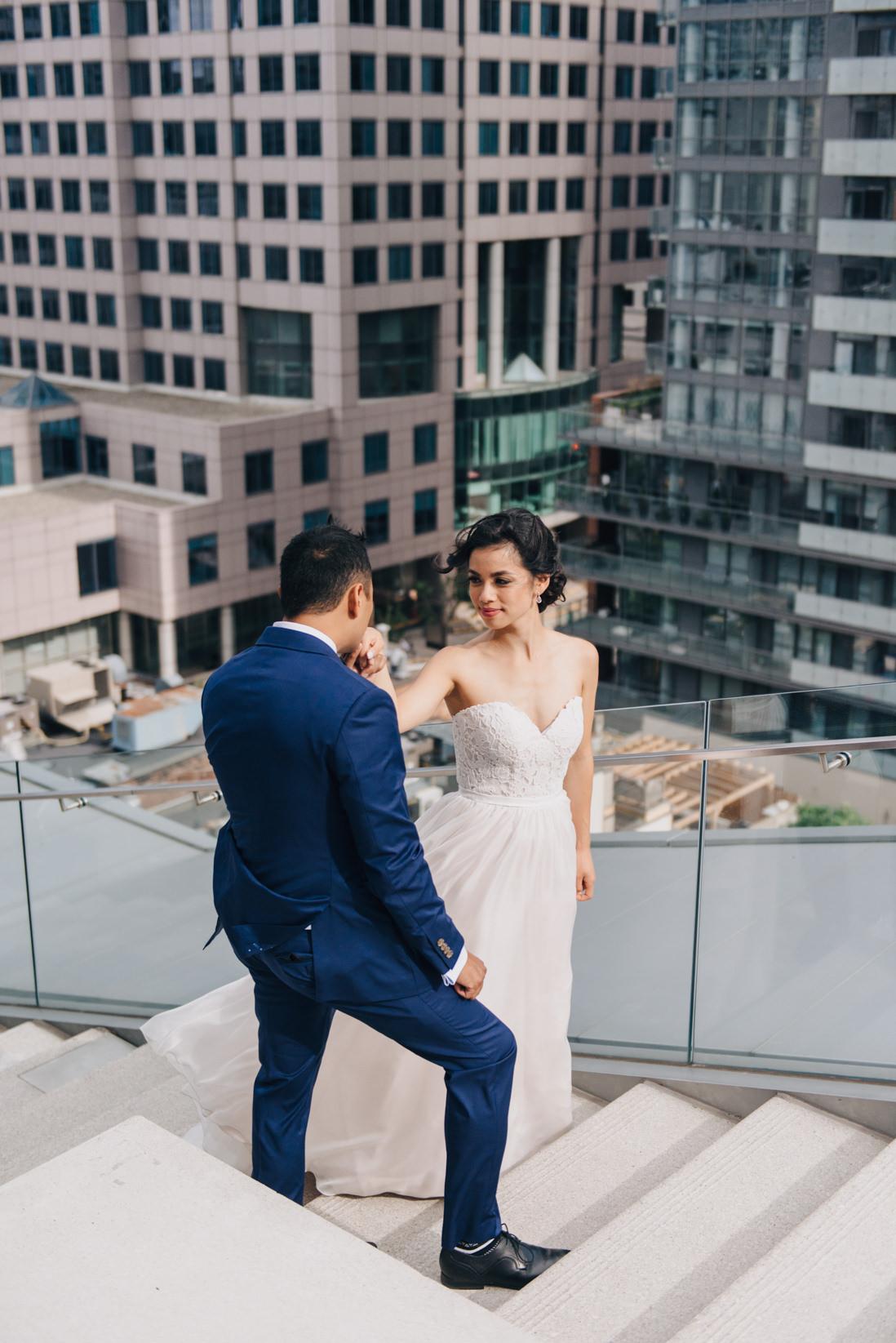 groom kissing brides hands on steps at malaparte wedding toronto wedding photographer
