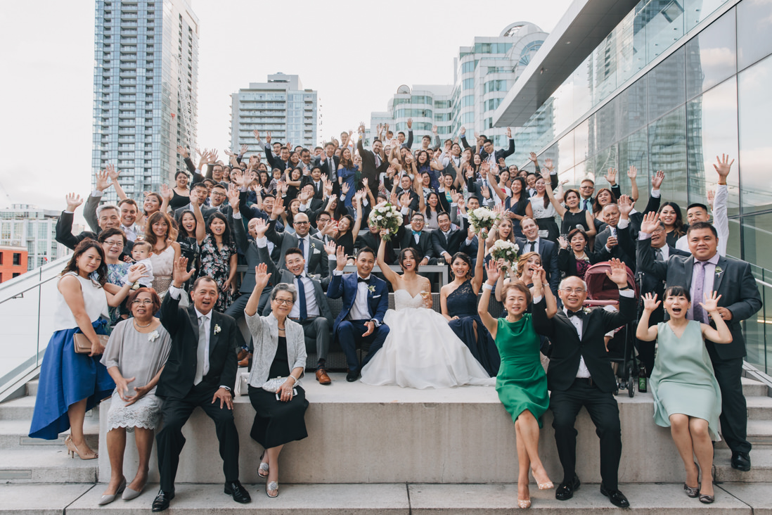 massive group photo of all guests on terrace at malaparte wedding toronto