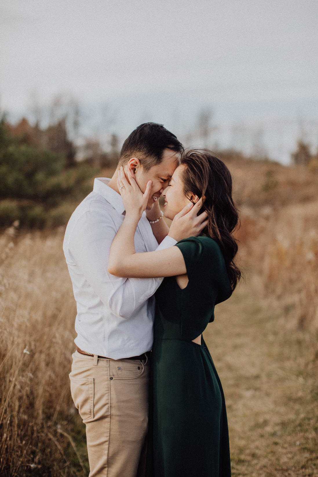 couple cupping each others face fall engagement caledon | eightyfifth street photography