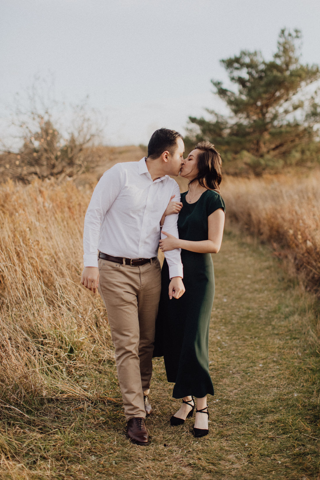 couple kissing mid walk fall engagement | eightyfifth street photography