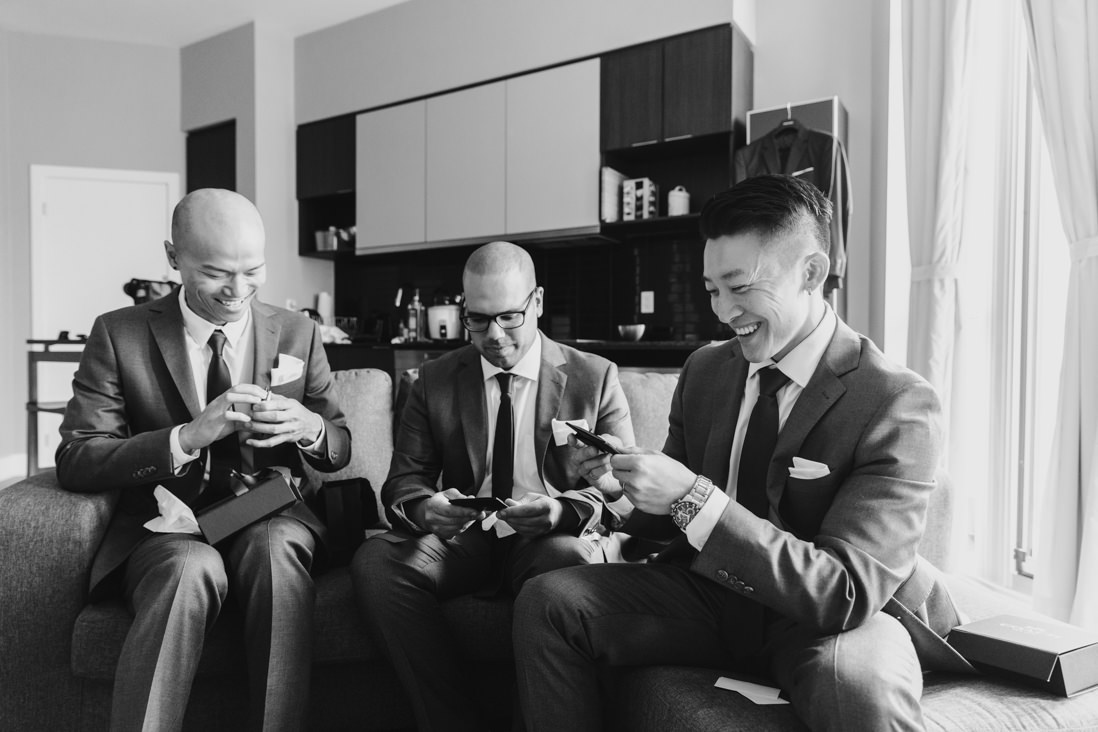 Groomsmen opening gifts Toronto_Wedding_Photographer_EightyFifth Street Photography