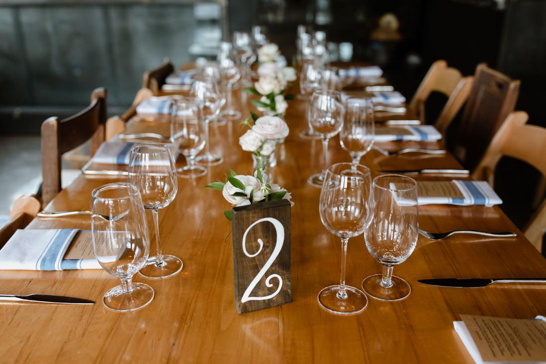 wedding reception decor table wood numbers Propeller Coffee Co Wedding Toronto_EightyFifth Street Photography