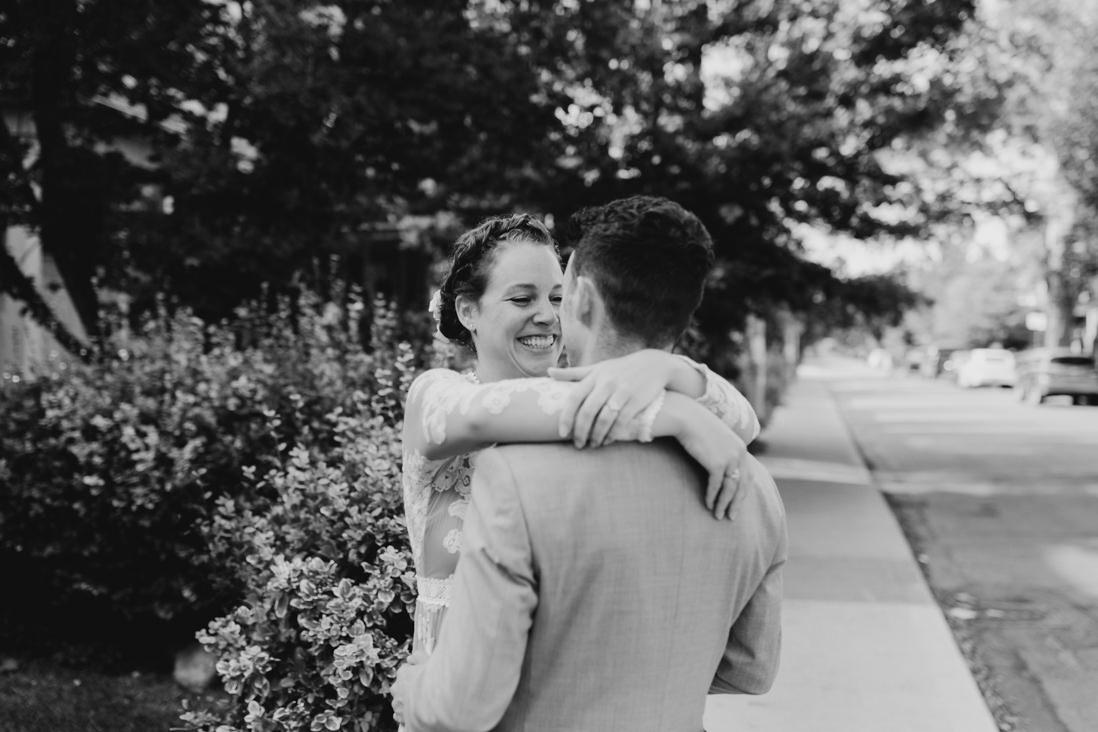 bride and groom in front of hydrangea bush urban Wedding Toronto_EightyFifth Street Photography