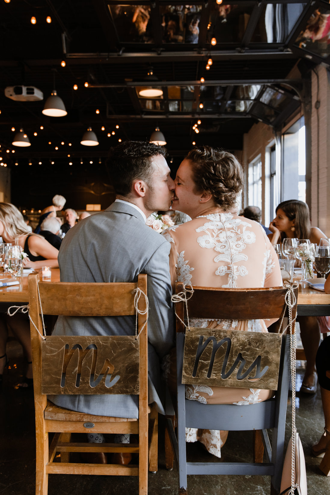 bride and groom kissing at wedding reception Propeller Coffee Co Toronto_EightyFifth Street Photography