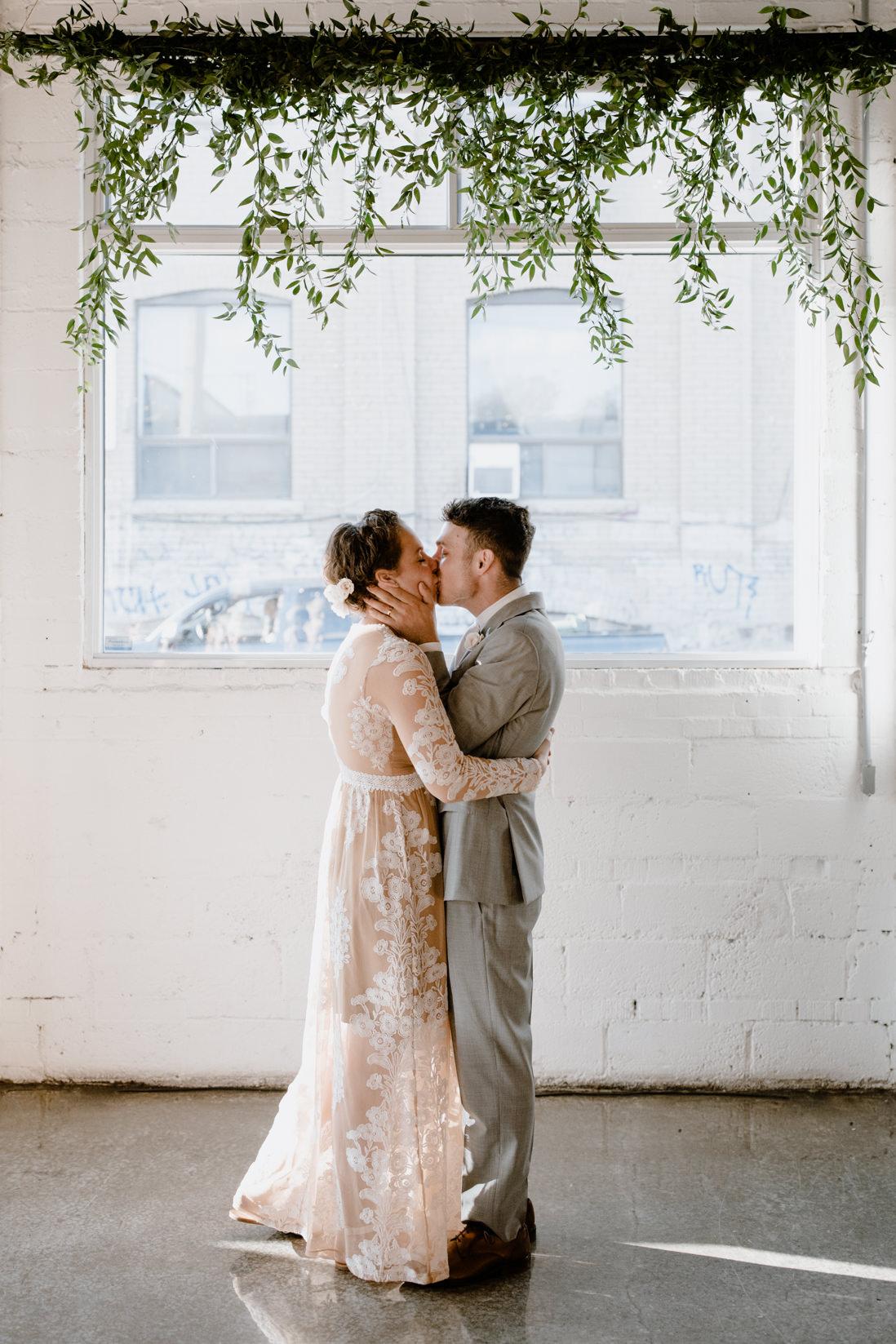first kiss wedding ceremony Propeller Coffee Co Toronto_EightyFifth Street Photography