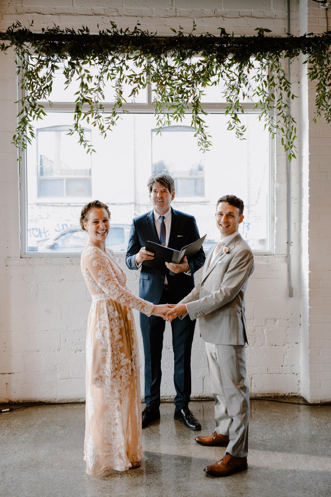 italian ruscus backdrop wedding ceremony Propeller Coffee Co Wedding Toronto_EightyFifth Street Photography