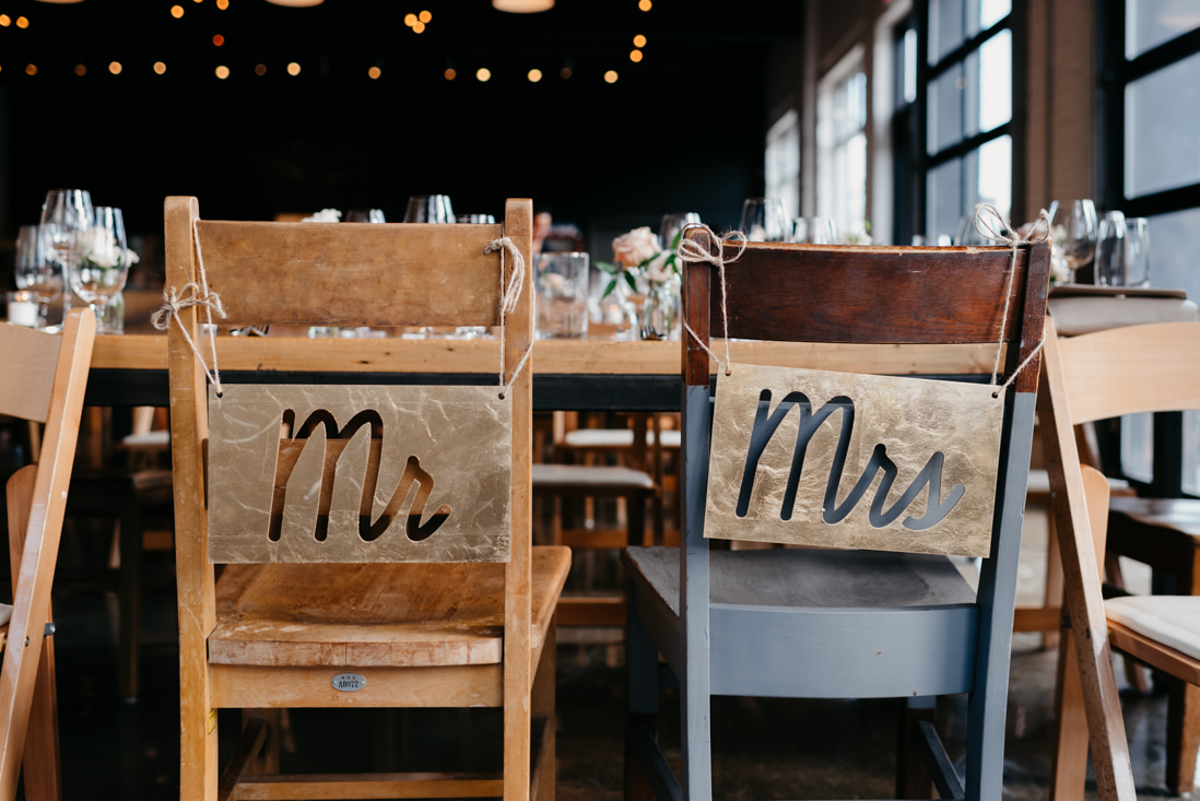 mr and mrs sign behind bride and groom's chairs Propeller Coffee Co Wedding Toronto_EightyFifth Street Photography