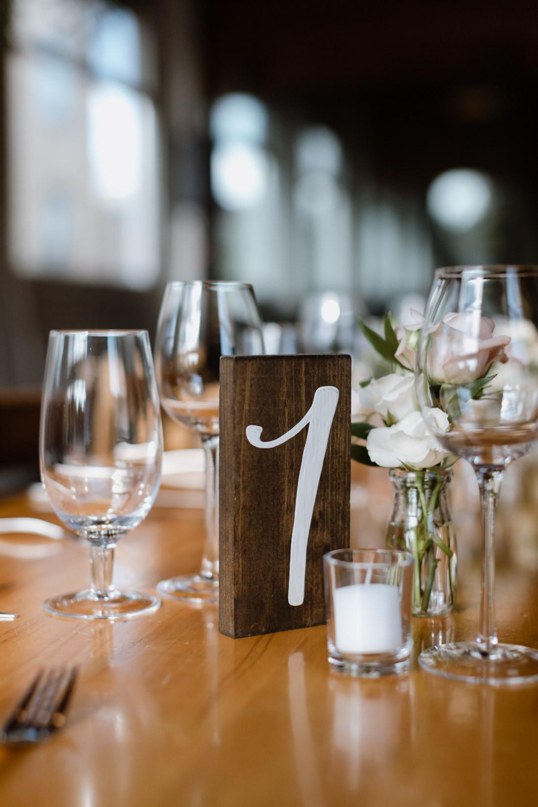 wood table numbers wedding reception Propeller Coffee Co Wedding Toronto_EightyFifth Street Photography